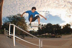 Skateboarding Ollie over Rail