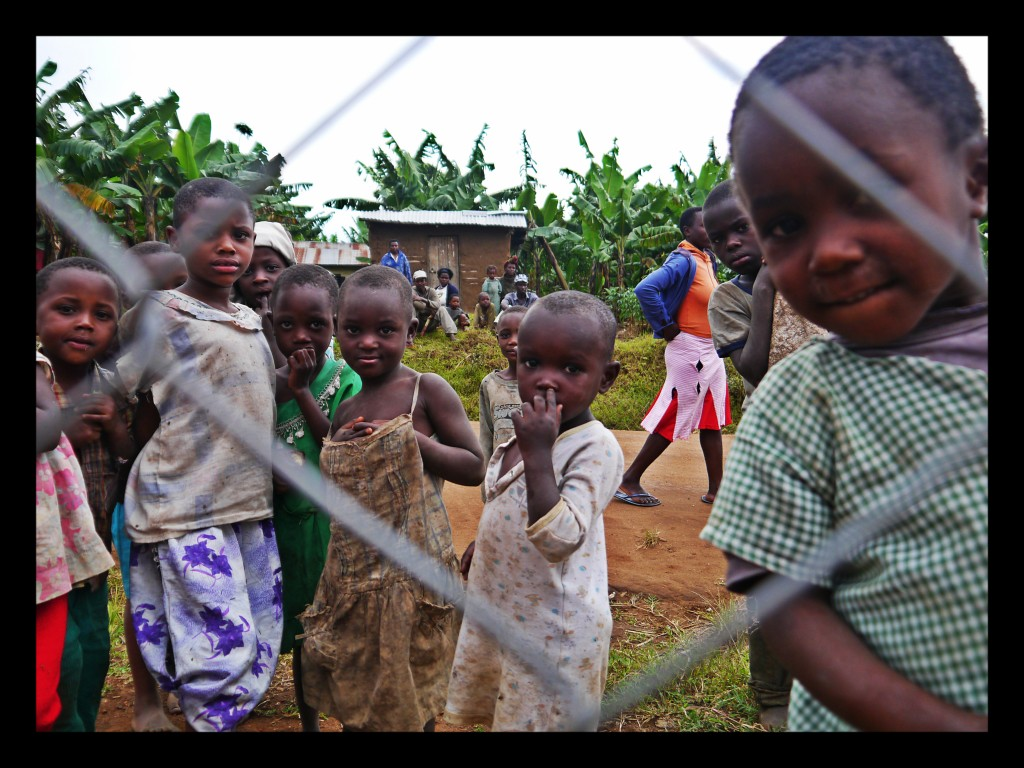 Uganda kids behind the fence