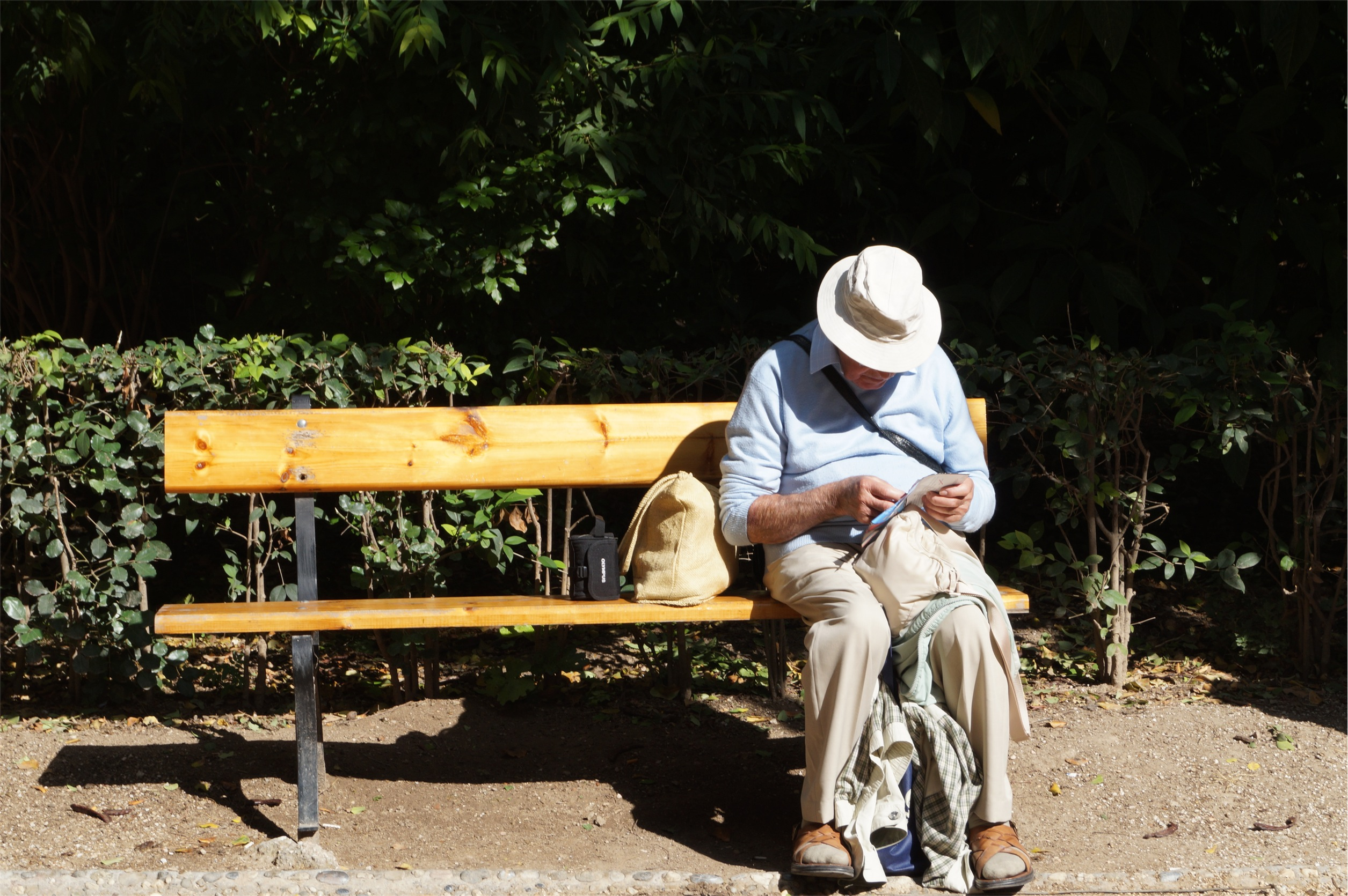 elderly man sitting on a bench